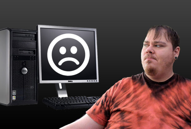 Looking Disappointed at a Dell Desktop